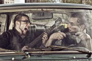 Inside car - art - playing guitar